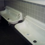 White porcelian trough urinal